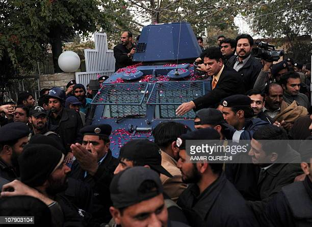 Pakistani police escort an armoured vehicle carrying arrested Pakistani bodyguard Malik Mumtaz Hussain Qadri the alleged killer of Punjab's governor...