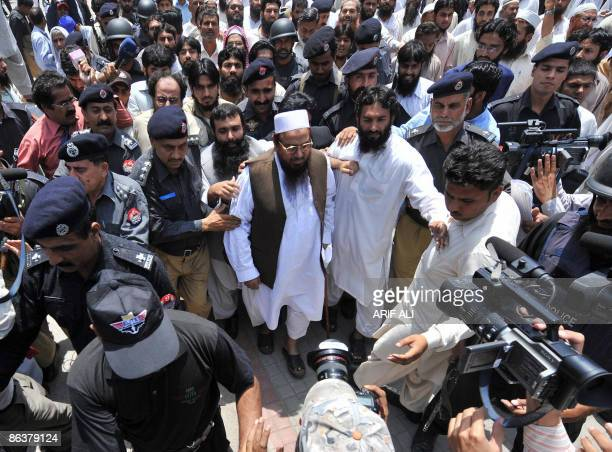 Pakistani police escort Hafiz Saeed the head of the banned JamaatudDawa and founder of LashkareTaiba outside a court as he leaves after a hearing in...