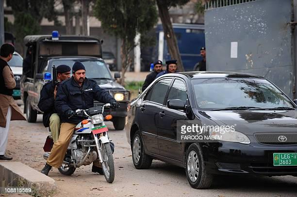 Pakistani police escort judge's car as they leave after the hearing of Malik Mumtaz Hussain Qadri at the Adiyala prison in Rawalpindi on February 4...