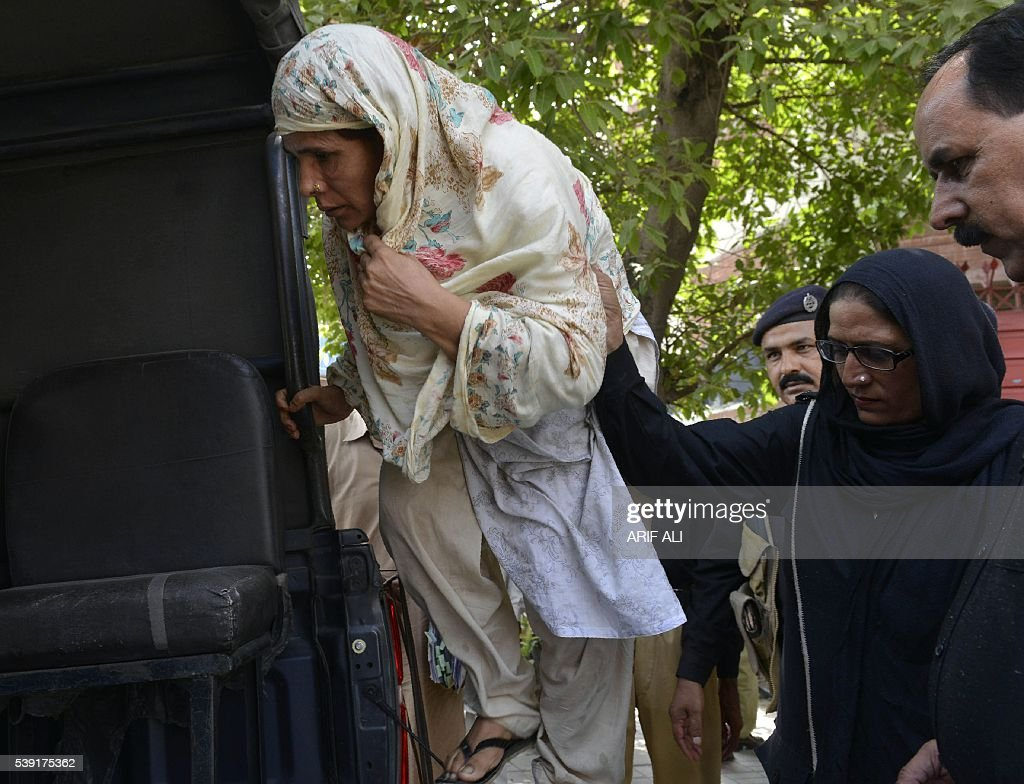 Pakistani Police Escort Perveen Bibi L Who Allegedly Killed Her Own Daughter By Burning Her Alive As They Go To Local Court In Lahore On June 10 2016