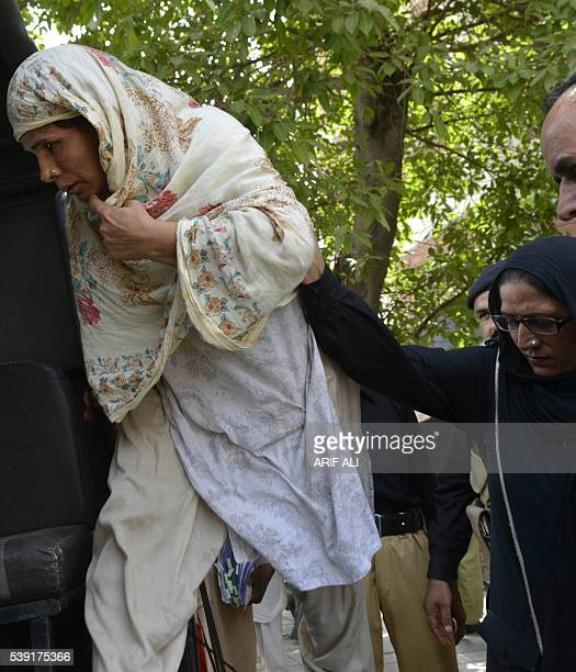 Pakistani Police Escort Perveen Bibi Who Allegedly Killed Her Own Daughter By Burning Her Alive As