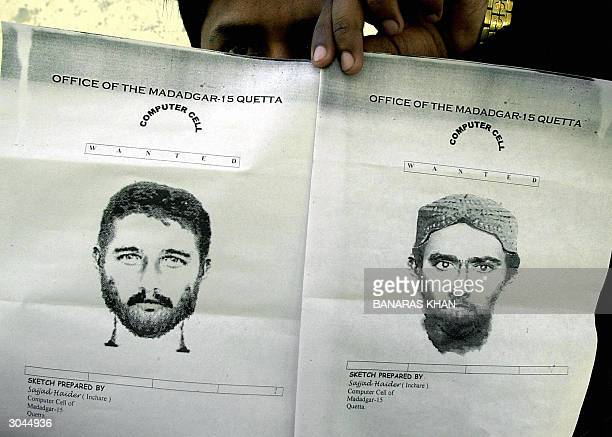 Pakistani police officer shows sketches of two men suspected in the attacks of Quetta's Shiite religious procession in Quetta 05 March 2004 Almost 50...