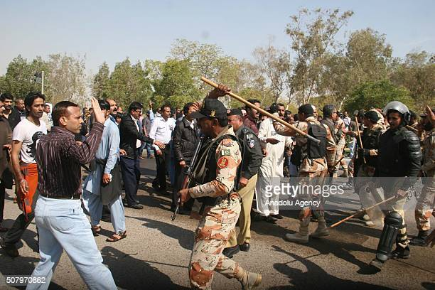 Pakistani police officers intervene to Pakistan International Airlines workers protesters as they marched towards the Karachi airport from PIAs head...