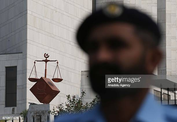 Pakistani police officers take security measures around the High court during the trial of Prime Minister Nawaz Sharif as the highest court met their...
