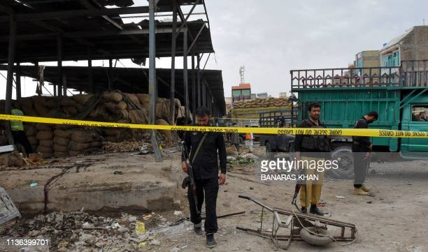 TOPSHOT Pakistani police officials cordon off the site after a bomb blast at a fruit market in Quetta on April 12 2019 At least 16 people were killed...