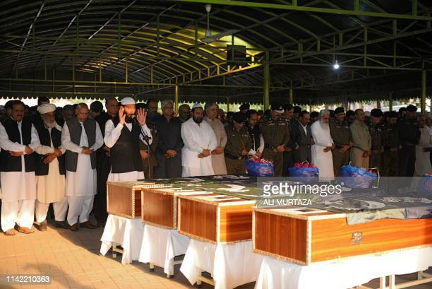 Pakistani police officials offer funeral prayers for their slain colleagues in a suicide blast in Lahore on May 8, 2019. - A blast at one of...