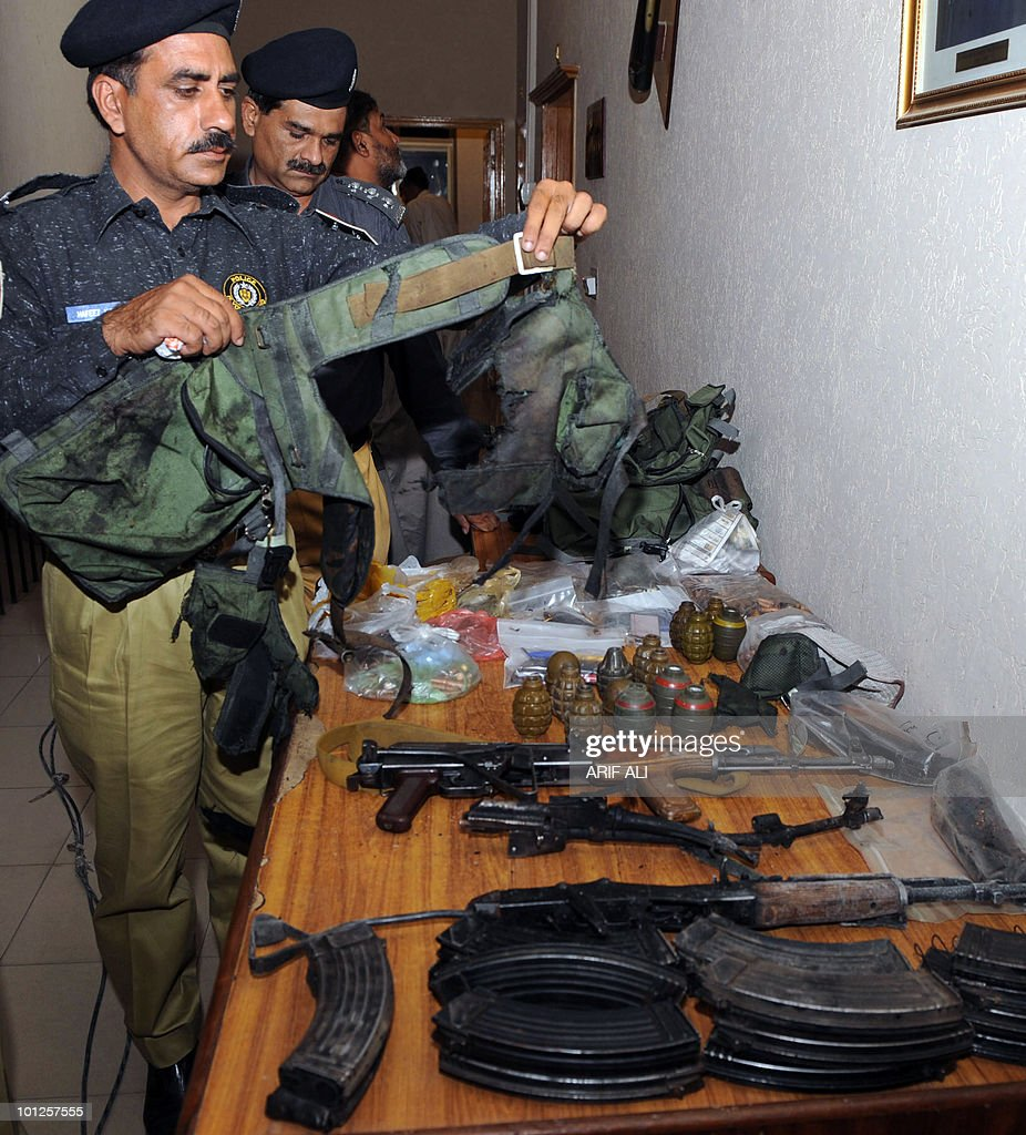 Pakistani police officials show arms and ammunition recovered from Islamic militants who attacked the minority sect mosques in Lahore on May 29, 2010. Police said it has also recovered grenades, Kalashinkovs,detonators, three suicide vests and four kilogrammes of explosive from the two sites. Victims of Friday's deadly attacks on two Pakistani mosques were Saturday buried separately after sect members cancelled a mass funeral for more than 80 people, fearing further attacks. AFP PHOTO/Arif ALI