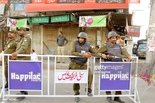 Pakistani police on duty for Muharram procession
