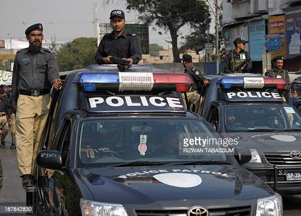 Pakistani police patrol a street during a religious procession held on the eighth day of Muharram to commemorate the martyrdom of Imam Hussain the...