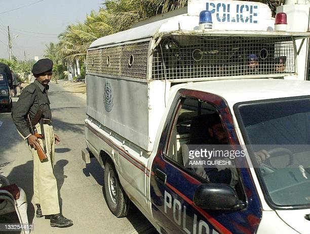 Pakistani police patrol where the missing Wall Street Journal correspondent Daniel Pearl was residing before he was abducted, in Karachi, 31 January...