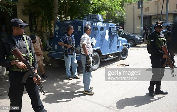 Pakistani police personnel stand guard as suspected militants appear before a court in Karachi on May 21 2015 Five men have been arrested in...