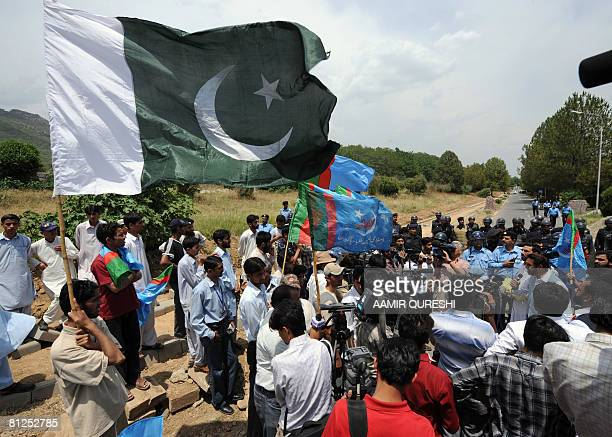 Pakistani police prevent the activists of Jamiat Tulba Islam a student wing of fundamentalist Islamic party of JamaatiIslami as they try to rush...
