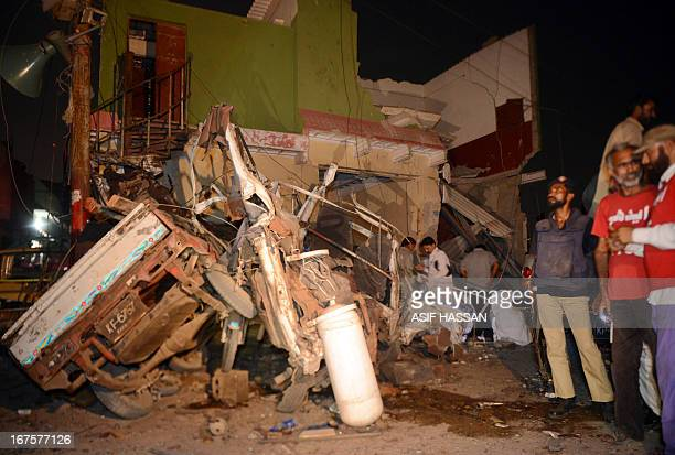 A Pakistani policeman and volunteers gather at the site of a bomb explosion on the office of the Pashtundominated Awami National Party in Karachi on...
