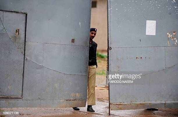 A Pakistani policeman closes the gate of Adiala prison in Rawalpindi on February 12 after the case hearing of assassination of exprime minister...