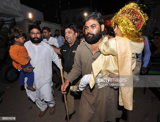 A Pakistani policeman escorts relatives of an underage girl and boy during a wedding ceremony in Karachi on October 31 2008 Police arrested the pair...