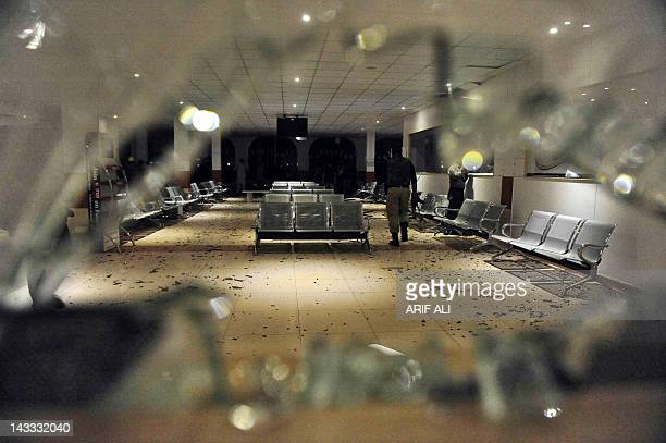 A Pakistani policeman examines the damaged train waiting lounge after a bomb blast in Lahore on April 24 2012 A bomb exploded near a luxury train...