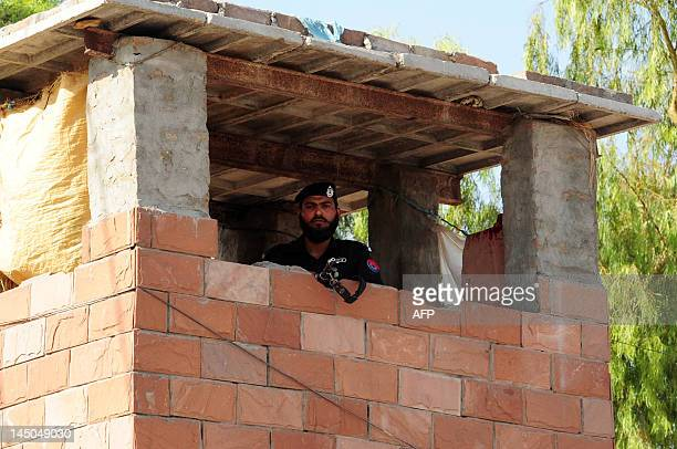 A Pakistani policeman keeps vigil on top of a bunker of the Peshawar central jail where Pakistani surgeon Shakeel Afridi who worked for US...