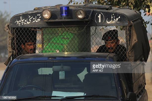 Pakistani policeman look on from a vehicle following the execution of Ajmal Kasab who was the sole surviving gunman of the 2008 Mumbai attacks at...