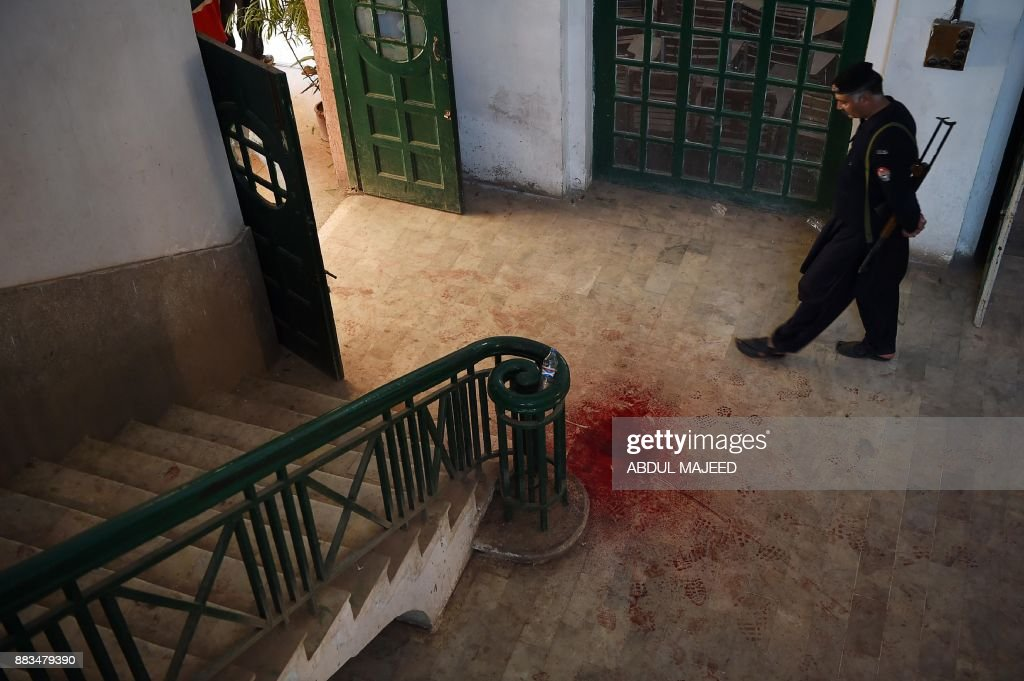 Pakistani policeman looks a blood-stained floor of an Agriculture Training Institute following an attack by Taliban militants in Peshawar on December 1, 2017. Nine people were killed and dozens injured on December 1 when Taliban militants stormed a training institute in the northwestern city of Peshawar as Pakistan marked the birthday of the Prophet Mohammed, officials said. /