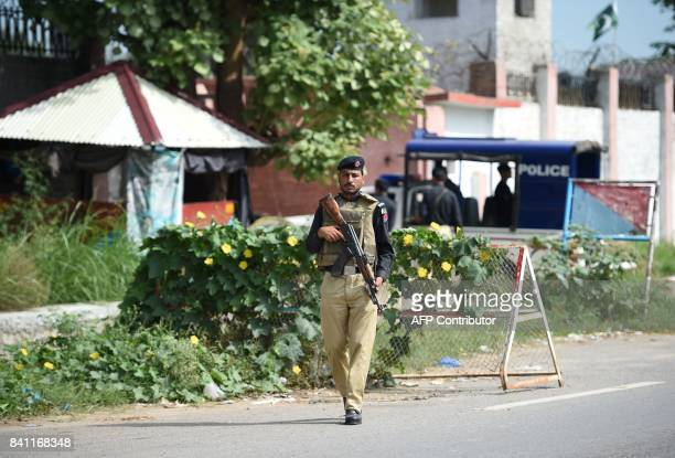 A Pakistani policeman patrols outside the gate of the Adyala Prison in Rawalpindi on August 31 before the announcement of the verdict in exprime...