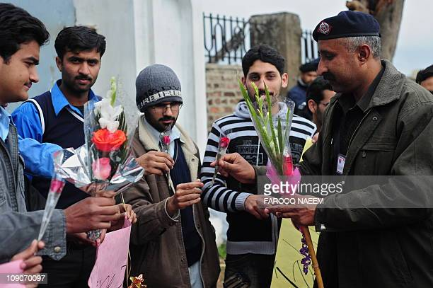 Pakistani policeman receives flowers and cards from students for detained self-confessed killer Malik Mumtaz Hussain Qadri outside the Adiyala prison...