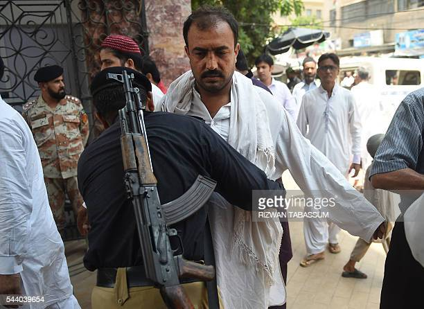 A Pakistani policeman searches a Muslim arriving for JummatulVida the last congregational Friday prayers in the holy month of Ramadan at a mosque in...