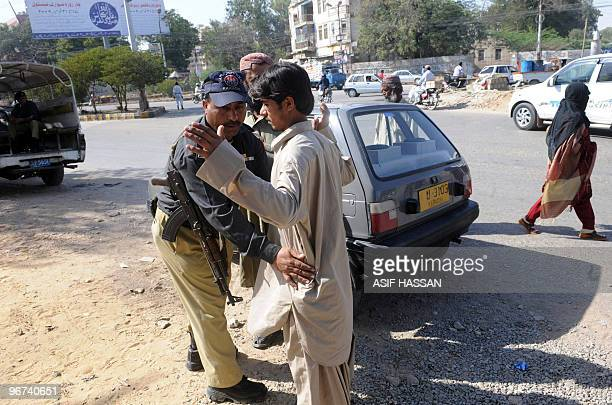Pakistani policeman searches a pedestrian at a security check point in Karachi on February 16, 2010. Pakistan's Interior Minister Rehman Malik...