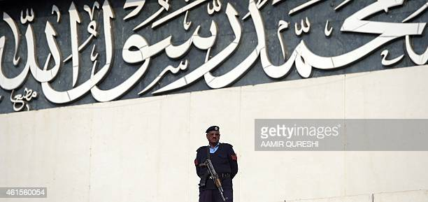 A Pakistani policeman stands guard at the Parliament House building in Islamabad on January 15 2015 Pakistan's parliament on January 15 passed a...
