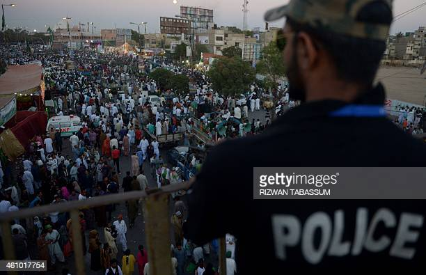 A Pakistani policeman stands guard during a gathering to celebrate the birthday of the Prophet Mohammed in Karachi on January 4 2015 The birthday of...