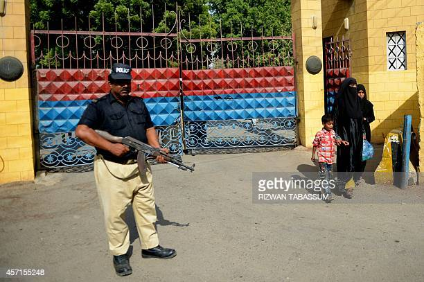A Pakistani policeman stands guard in front the main entrance of the Karachi Central Prison in Karachi on October 13 2014 Pakistani officials said...