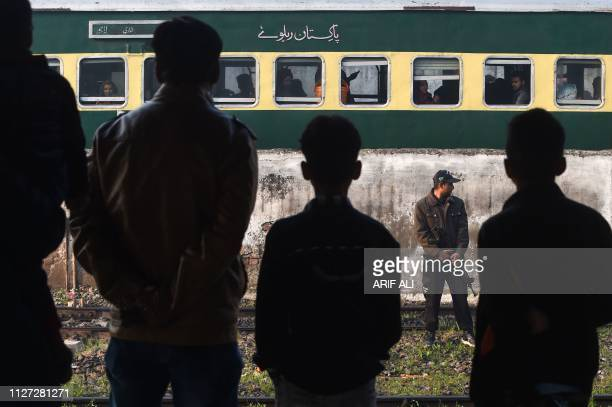 Pakistani policeman stands guard near the Samjhota Express train travelling to India at Lahore railway station on February 25 2019 Pakistan's...