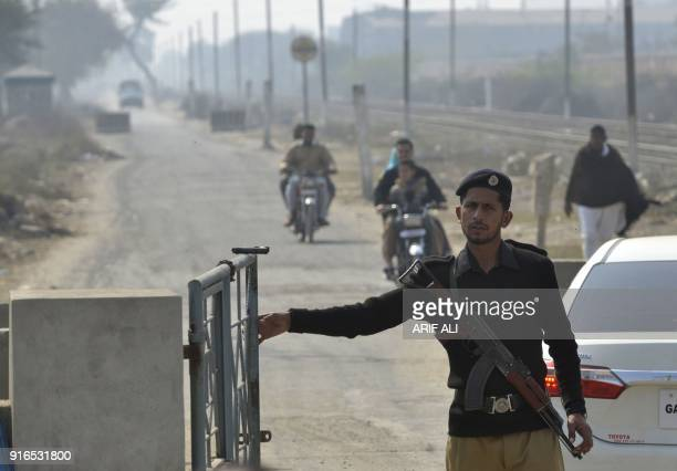 A Pakistani policeman stands guard outside the check pint of Kot Lakhpat Jail where Mohammad Imran the suspect accused of raping and murdering a...