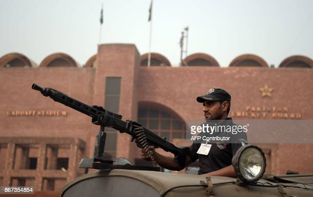 A Pakistani policeman stands guard outside the Gaddafi Cricket Stadium ahead of the last T20 cricket match is scheduled between Pakistan and Sri...