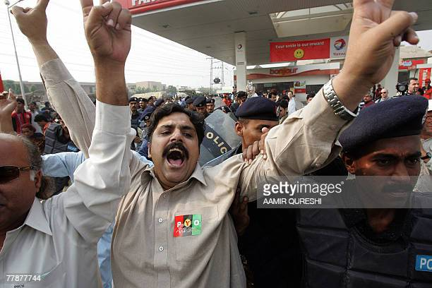 Pakistani policemen arrest supporters of former Pakistani prime minister Benazir Bhutto during a protest outside the Bhutto residence in Lahore 13...