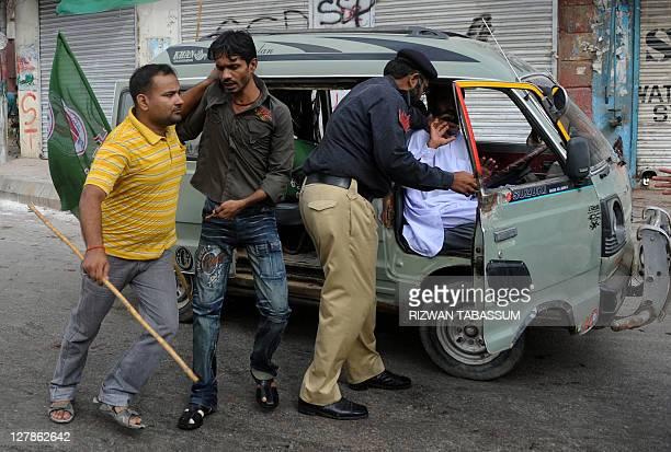 Pakistani policemen arrest supporters of Malik Mumtaz Hussain Qadri during a protest in Karachi on October 2, 2011. A Pakistani court on October 1,...