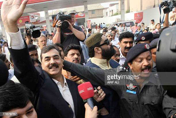 Pakistani policemen arrest Yousuf Raza Gilani leader of Pakistan People's Party of former premier Benazir Bhutto near a house where she is staying in...
