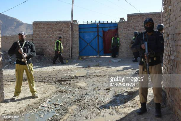 Pakistani policemen cordon off the site of an attack by gunmen on a polio vaccination team on the outskirts of Quetta on January 18 2018 A mother and...