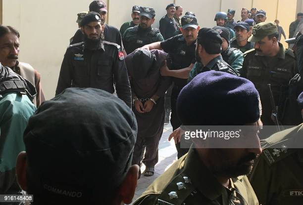 Pakistani policemen escort a suspect accused of raping and murdering a young girl as they leave an antiterrorist court after a hearing in Lahore on...