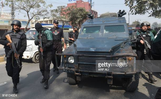 Pakistani policemen escort an armoured vehicle carrying the suspect accused of raping and murdering a young girl outside an antiterrorist court in...