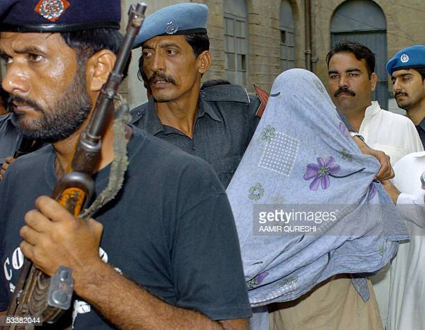 Pakistani policemen escort arrested alleged Islamic extremist Hashim Qadeer, who is suspected of the murder of Wall Street Journal reporter Daniel...