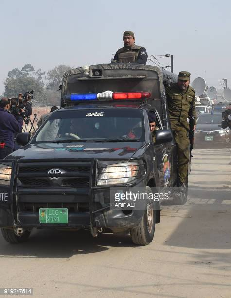 Pakistani policemen escort judge car arrives at the Kot Lakhpat Jail before the court verdict in Lahore on February 17 2018 A Pakistani court on...