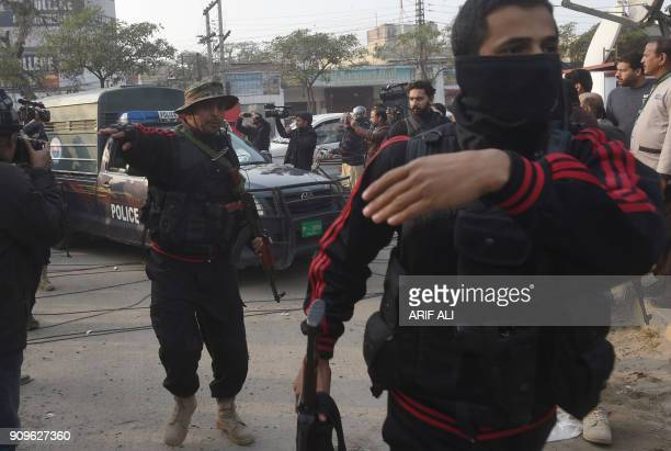 Pakistani policemen escort the police van carrying a suspect accused of raping and murdering a young girl as they arrive at an antiterrorist court in...