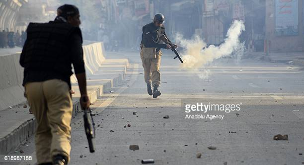 Pakistani policemen fire teargas shells at stonethrowing supporters of opposition party of TehreekeInsaaf of Imran Khan during a clash in Rawalpindi...