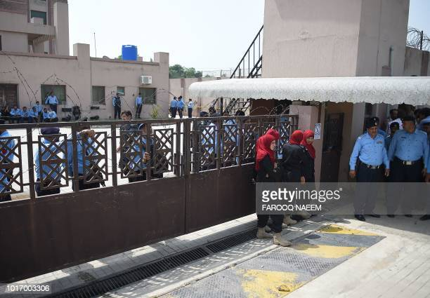 Pakistani policemen gather at the corruption court building during the case hearing of jailed former Pakistani Prime Minister Nawaz Sharif in...