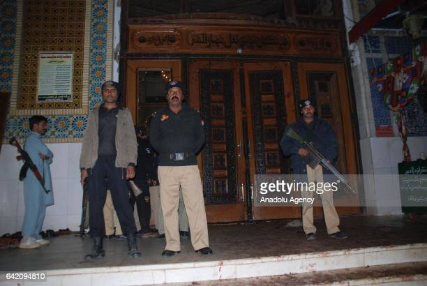 Pakistani policemen gather at the site of a suicide attack at the 13th century old shrine of a Muslim saint in the town of Sehwan in southern Sindh...
