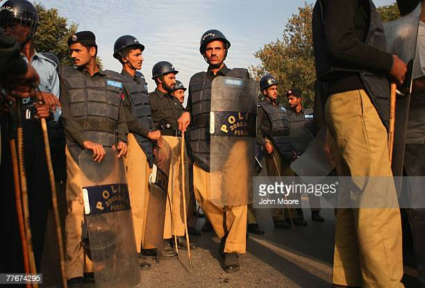 Pakistani policemen gather to confront antigovernment protesters on November 4 2007 in Islamabad Pakistan A small group of protesters held signs and...