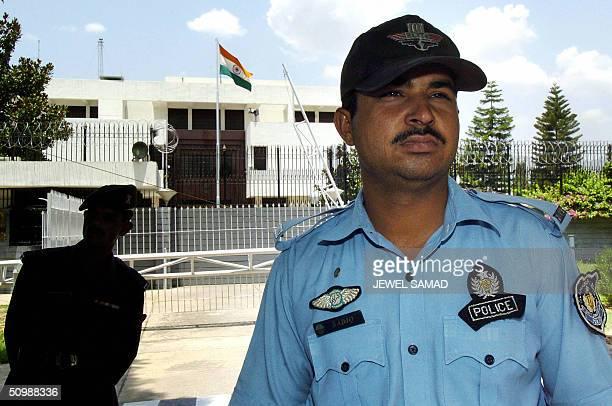 Pakistani policemen keep an eye on activists belonging to the Pakistani faction of the Kashmiri pro-independence organisation Jammu Kashmir...