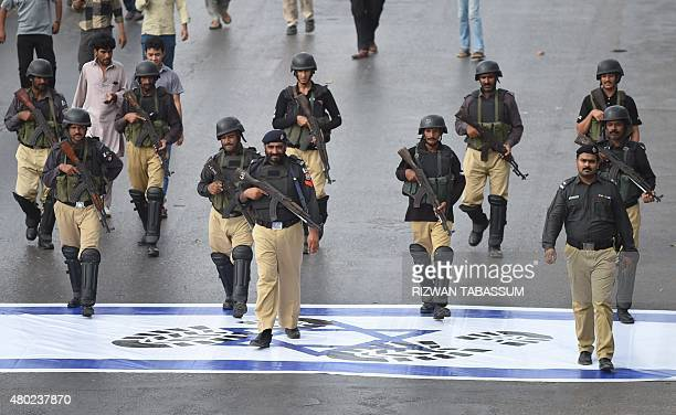 Pakistani policemen lead the march as Shiite Muslims mark Quds Day rally in Karachi on July 10 on the Friday of the Islamic holy month of Ramadan AFP...