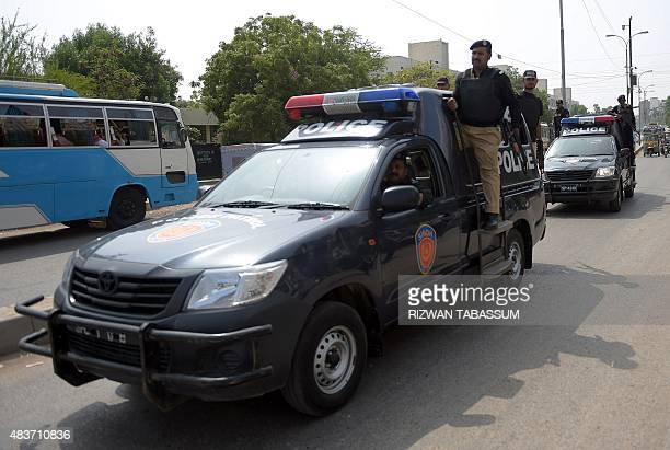 Pakistani policemen patrol along a street in Karachi on August 12 2015 Pakistani security forces said they had foiled a plot to bomb Independence Day...