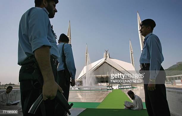 Pakistani policemen patrol at the Faisal Mosque in Islamabad 05 October 2007 Pakistan is on high security alert for presidential elections to be held...